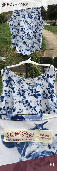 Faded Glory White Blue Floral Tank Top XXL 20 (18) Faded Glory Women's white tank top with blue flowers is size XXL (20) but runs small. It fit my daughter like it was an (18). She loved the blue floral pattern but too small. Top was made in China of 100% polyester. It is not new and was bought at a 2nd hand store. Faded Glory Tops Tank Tops