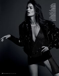 Photographed in black and white, Lily Aldridge wears Diesel Black Gold jacket, Anthony Vaccarello dress and Bulgari necklace