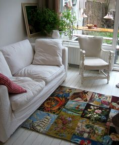 Beautiful carpet made from old finished needlepoint pieces.