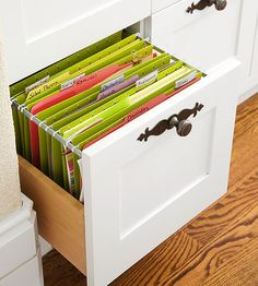 Plentiful storage space frees the office area from paper pileups. A drawer equipped with hanging folders keeps school documents, medical rec...