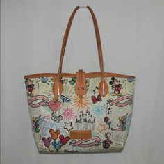 """Dooney bourke Disney large Sketch shopper bag tote Large tote from Dooney and bourke from Disney line. This large shopper is no longer made. Dimensions are 15.5""""Wide at top and 11"""" Wide at base., 10.5"""" High, 5.5"""" Deep with 8"""" strap drop. Closes with snaps and flap over in leather. Position is great as castle is center on each side. Some pink spots from """"bleeding"""" of colors that occurs on white bags. Also discoloration on base and in spots. Noticeable close up. See photos and let me know if…"""