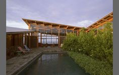 Rolling glass doors. Ohana House | Cutler Anderson Architects