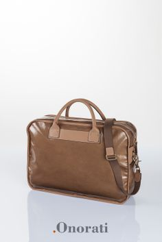 """""""Never ask what sort of computer a guy drives. If he's a Mac user, he'll tell you. If not, why embarrass him?"""" (Tom Clancy) Shooting service taken to showcase the .Onorati's handbags mood for .Onorati Srl :: www.onorati-fashi... :: @.Onorati  @Marco Lodovichi ( with marcolodovichi.com & triiimpuls.com )"""