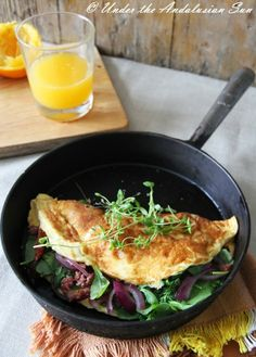 For a little better morning: omelette with cold smoked reindeer, rucola, red onions, sun dried tomatos...