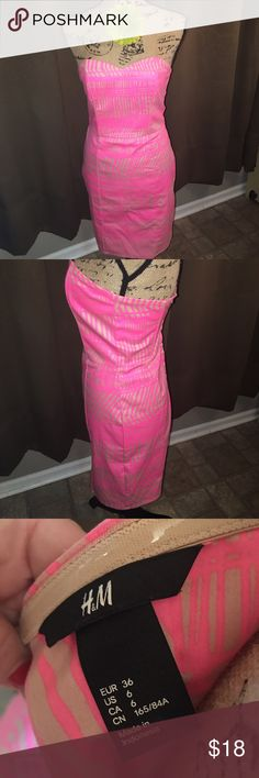 H&M dressHOST PICK Awesome pink n tan H&M dress size 6.. it looks small in my opinion so the measurements are bust n waist 13' & hip 16' ( across back) and the length from top to bottom is 25' H&M Dresses