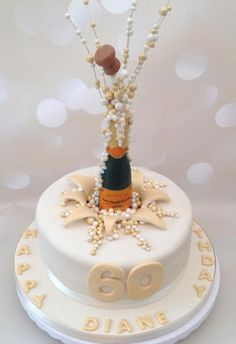 This lady's favourite champagne brand is featured here. Her family wanted it exploding out of the top of the cake