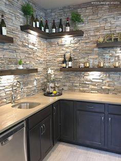 Beautiful wet bar with floating shelves and stone! #basementremodeling