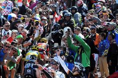 Stage 12 Tour de France 2016 Spectator mayhem obscures riders, leader of tour foot races towards finish.
