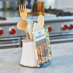 The Utensil Crock Cookbook & Tablet Holder combines 2 of your most-used kitchen items: a utensil caddy and a recipe stand.