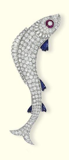 AN ART DECO DIAMOND BROOCH, CIRCA 1930. Designed as a pavé-set diamond leaping fish with baguette-cut diamond dorsal fin and triangular-cut diamond mouth, 8.2 cm long.