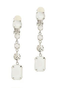 These Tory Burch drop earring add iridescent shine to casual basics and a polished finish to dressier looks.