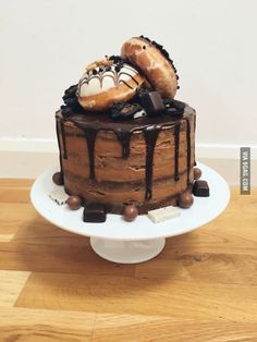 Chocolate cake with espresso butter cream icing topped with Krispy Kreme, chocolate Oreos, Malteasers, Cookies and Cream Hershey's...