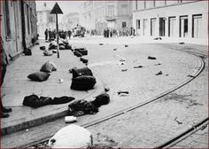 Liquidation of the ghetto in Krakow, Poland, with belongings of deported Jews strewn about the streets, March 1943.