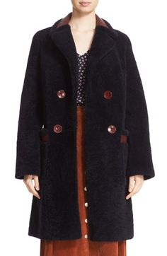Free shipping and returns on Diane von Furstenberg 'Grayson' Reversible Genuine Shearling Coat at Nordstrom.com. Two compelling looks in one luxurious style, a structured notch-collar coat reverses from its plush soft fur side to rugged grained leather. Contrast-color trim and buttons polish the double-breasted design.