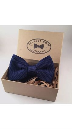 The Belfast Bow Company present their Knitted bowtie in Deep Navy Blue - the classic colour and traditional style offer the perfect finish to a gentlemans formal outfit or suit. Your bowtie is presented in a beautiful hand finished Kraft gift box, making them the ideal gift for fathers day, groomsmen, christmas and birthdays.  The bowtie is pre-tied and fixed to maintain its shape. It has an adjustable strap with a hook & eye fastening that will fit almost all neck sizes.  Please dont hes...