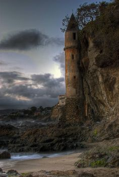 """""""Pirate Tower"""" of Victoria Beach in Laguna Beach, CA. How I lived in Corona del Mar and never saw this is beyond me. The tower is actually a staircase leading from house above down to beach. Bette Midler lived in the home during the '90s."""