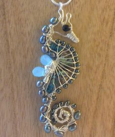 Gemstone seahorse by CurlyKitty on Etsy. Handmade wire wrapped seahorse. Made using various gauges of silver plated copper wire and various gemstones.