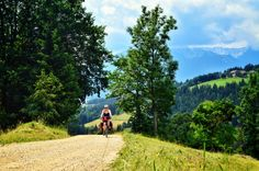 Carolyn grinding up the long steep gravel road climb to Ekohotel Kmetija Koros