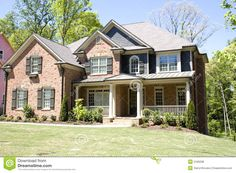 A nice brick house on a new lawn with a veranda. Description from dreamstime.com. I searched for this on bing.com/images