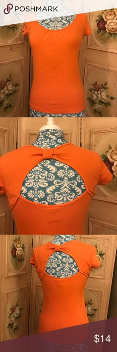 Open Back Orange Blouse Small Orange Blouse with unique back design (cut-out) Excellent Used Condition. Small by Rafaella Studio 100%Cotton Rafaella Tops Blouses