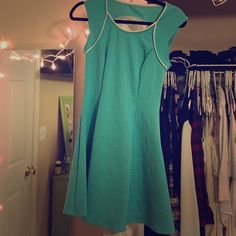 Very pretty teal/ greenish dress! Never worn! Fits a small medium, stretchy material Dresses