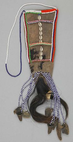 Africa | Necklace from the Turkana people of the Rift Valley Province in Kenya | ca. 1980 | Animal skin, cowrie shells, hair, hoof, plant fiber and horn.