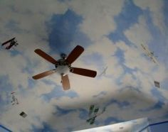 Airplanes, sky in boys room. I would have used a white ceiling fan. Aviation Decor, Airplane Decor, Boys Room Decor, Boy Room, White Ceiling Fan, Cloud Ceiling, Litle Boy, Airplane Painting, Ceiling Murals