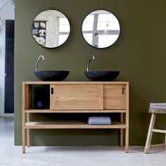 Retro Style Unpolished Birch Wood Vanity Table With Black Ceramic Bowl Sink And Sliding Door Panel Combined With Round Frameless Wall…