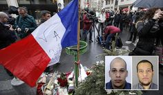 """A French flag flutters after being erected with flowers outside the Charlie Hebdo newspaper in Paris, Thursday, Jan.8, 2015, a day after masked gunmen stormed the offices of a satirical newspaper and killed 12 people. Protesters in some U.S. cities — repeating the viral online slogan """"Je Suis Charlie"""" or """"I Am Charlie""""; demonstrated against the deadly terror attack on a Paris newspaper office, joining thousands around the world who took to the streets to rally against the ..."""