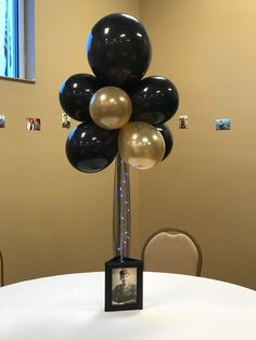 Photo frame and balloon centerpiece 50th Birthday Party Decorations, Graduation Party Centerpieces, Graduation Party Planning, 70th Birthday Parties, Graduation Decorations, Grad Parties, Anniversary Parties, 60th Birthday Balloons, Wedding Centerpieces