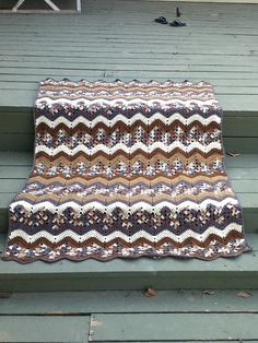 Cloudy Day Ripple Throw, free pattern by Mary Ann Frits (LW3080) from Red Heart.  Nice combination of solid & granny rows.  Pic from Ravelry Project Gallery.   . . . .   ღTrish W ~ http://www.pinterest.com/trishw/  . . . .   #crochet #afghan #blanket