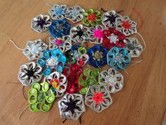 Pull tab flowers. Gloucestershire Resource Centre http://www.grcltd.org/scrapstore/