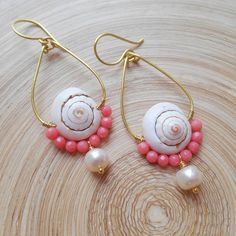 With its playful, beachy vibe and vibrant, feminine color story, Coralie seashell beaded hoop earrings have a carefree, earthy sophistication. Total height (including earwires); Width: Very lightweight, each earring weighs: