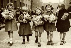 Reading ... love this picture and their smiles.  I remember how a trip to the library made me feel.