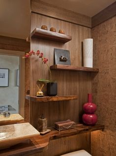 This whole space was meant to be a piece of art so it made sense to display our clients' art pieces on unique free-floating Indian Rosewood shelves.