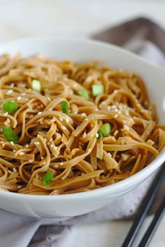 Sesame Noodles - A quick and easy 10 minute meal that is so delicious! Cold noodles topped with a light sesame sauce and tossed with sesame seeds and green onions. These sesame noodles are sure to be a new favorite!