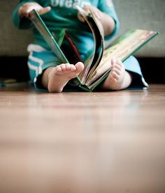 perspective from the floor of child reading a book || by arkworld on flickr