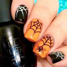 Halloween jack_o_lantern Freehand Spider and Webs Nails Ok this was so far the best picture I got with this bright color. It looks so beautiful in flushed person I used polishes from @hbbeautybar @opi_products Black Onyx @chinaglazeofficial Lady and the Vamp Details hand painted with black Acrylic art paint @glistenandglow1 Hk Girl top coat
