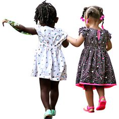 Two girls running and playing outside, holding hands. Background removed of this PNG file so they can jump right in to your digital rendering project.
