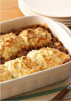 Biscuit-Topped Tomato-Beef Bake – This quick and easy casserole recipe is made with ground beef and tomato soup, and baked with cheesy biscuits on top.