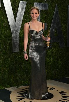 ...And Jennifer Lawrence rocks it again in this Calvin Klein number at the Vanity Fair Oscar party