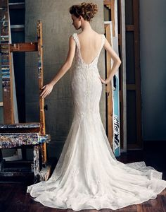 Lusan Mandongus - Hong Kong - A figure-hugging wedding dress with seductive sheer back.