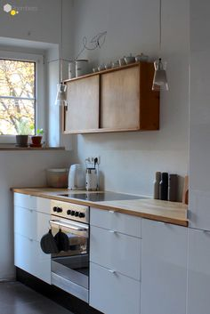 Cabinets: some white some wood.