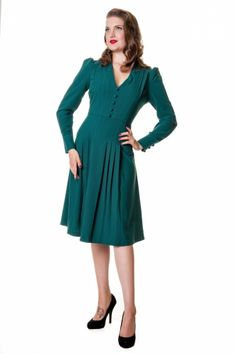 New Collectif autumn / winter collection! The Jenny flared dress in Vintage greenis a classy 1940s style flared dress.If you are a vintage lover, then this your dress! Made from a beautiful vintage-ish crepe fabric in a lovely warm green/blue colour with a light stretch on it. It is made from a thicker fabric and the top is lined which is perfect to keep you warm during the colder months.It features full height puffed sleeves finished with cuffs and covered butto...