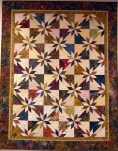 Hunters star - always like jewel tones. I would like to make this quilt for me.