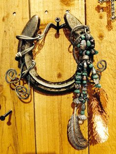Hey, I found this really awesome Etsy listing at https://www.etsy.com/listing/176304796/decorated-horseshoe-southwestern-feather