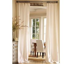 curtains from twin sheets:  Benefits: taller to vertically lengthen the look of the room, take sheet from the clips and wash at home (LOVE) , and ... you know.... cheap
