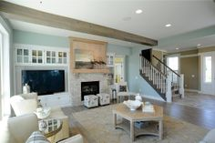 Living room with entertainment area and fireplace.