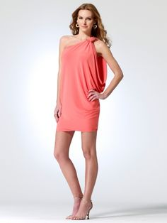 f984d182f81c Matte jersey one shoulder dress with cocoon sleeve. Buckle at shoulder. 92%  polyester