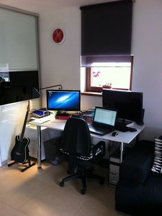 Vlads submission. Home office with Godin guitar.